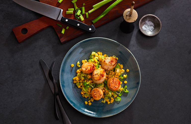 Seared scallops in olive oil with braised leeks