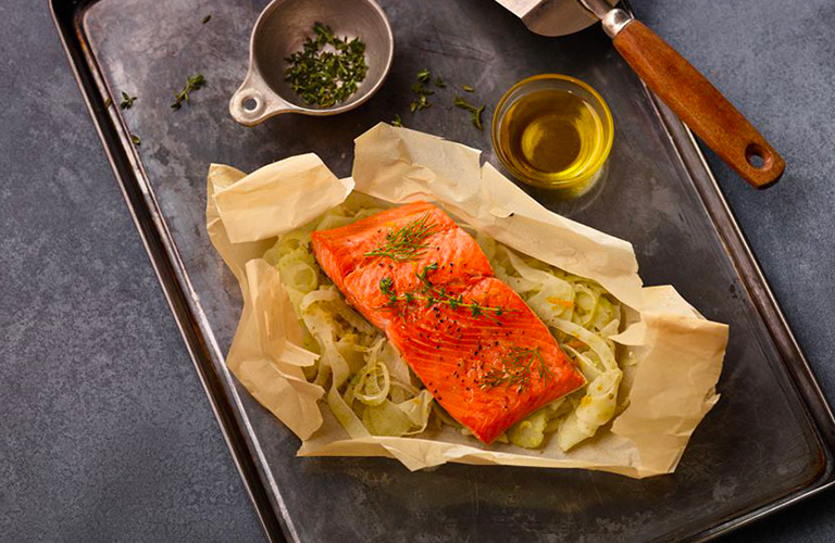 Herbed salmon and fennel en papillote with olive oil drizzle