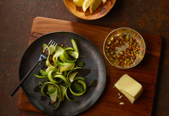 Cooking a recipe of zucchini carapaccio salad drizzed with olive oil and lemon   Carapelli
